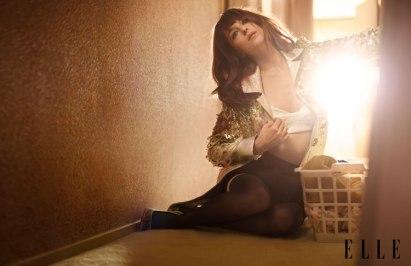 Skirt- Narciso Rodriguez, Bra Top & Coat- D-Squared, Thigh Highs- Donna Karan, Pumps- Louboutin